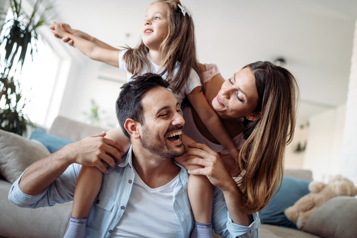 family laughing in living room
